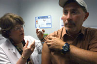 patient receives flu vaccine