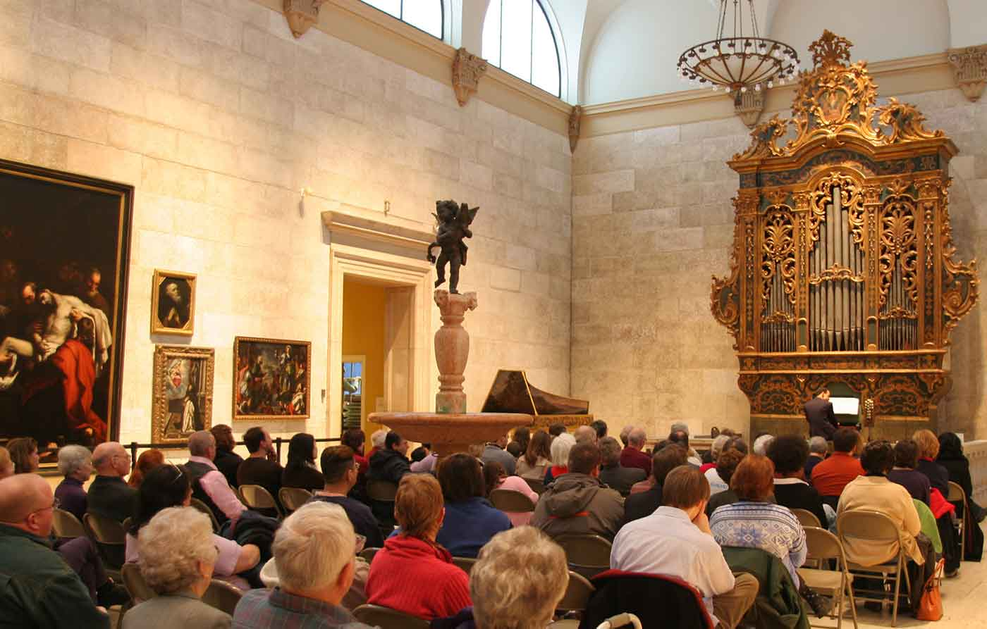 people listening to organ music