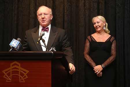 University Trustee Tom Wilmot and Judy Wilmot Linehan encourage attendees—many of whom were George Eastman Circle members—to join them in supporting cancer research at the Wilmot Cancer Institute during the 15th annual Discovery Ball.