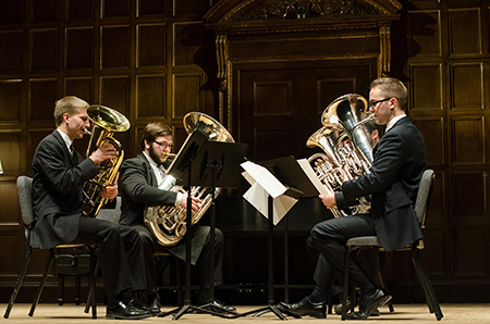 The Eastman School of Music's Carillon Tuba Quartet will perform at the New York City Holiday Party