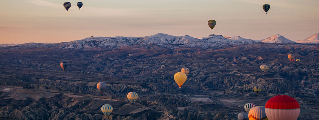 Hot Air Balloons Ascend, Cappadocia, Turkey, November 2014, Aaron Schaffer '15, an international relations major. Rochester Review 2015 Study Abroad Photo Contest winner.