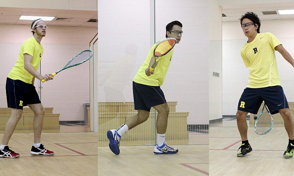 3 students playing squash