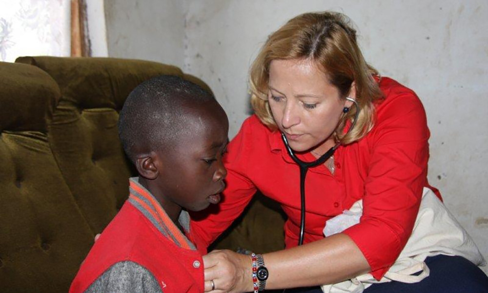 doctor listens to a child's heart with stethoscope