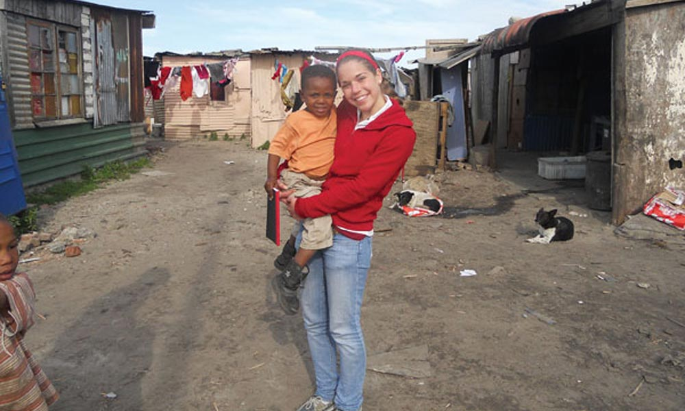 Katherine Wegman '15 holding child in South Africa