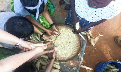 Students in the Malawi Immersion Seminar learn to process corn into nsima, a staple dish in the Malawian diet