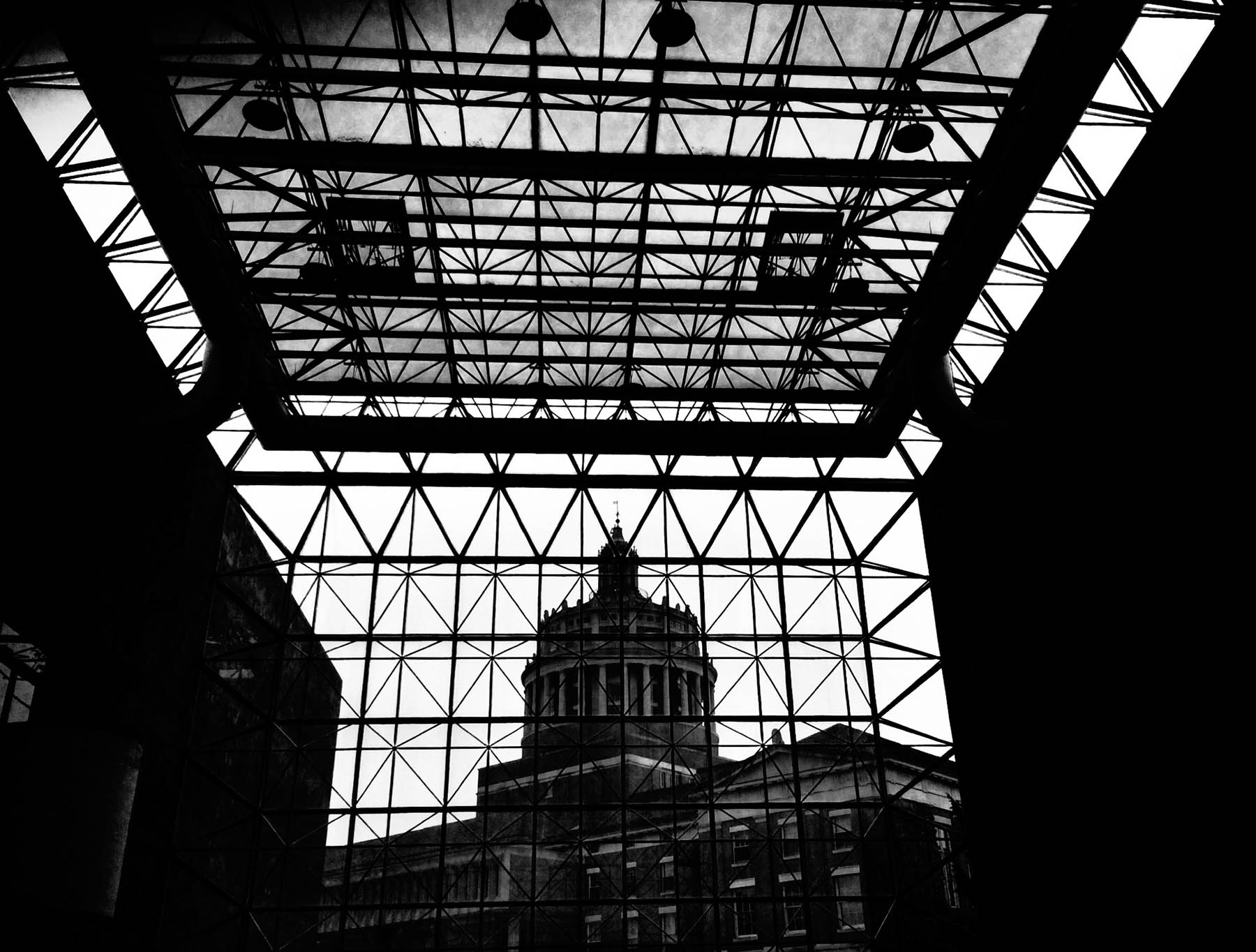 black and white view of library tower from inside Wilson Commons