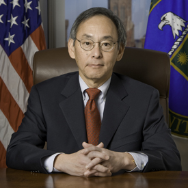 steven chu seated at a desk