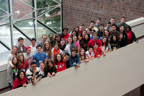 large group of students wearing greek letters