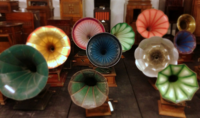 picture of colorful collection of antigue phonographs