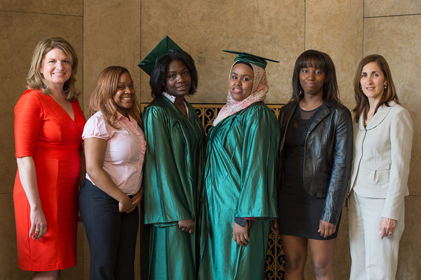 women standing with African American grads