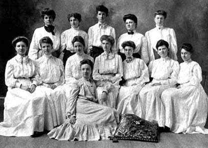women in Victorian dresses
