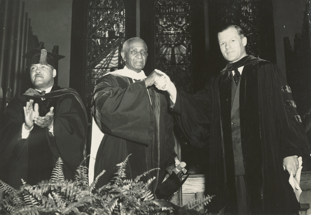 1941: President Alan Valentine presents an honorary degree to George Washington Carver, with Tuskegee President F. D Patterson. Photo courtesy of the Department of Rare Books, Special Collections, and Preservation