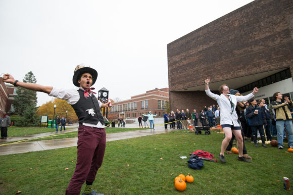 Noah Woolfolk '16 and Ben Parkinson '16 celebrate a successful trebuchet shot at the annual American Society of Mechanical Engineers Pumpkin Launch in 2014.