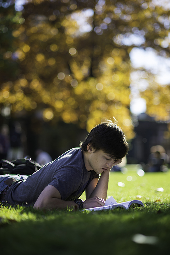 David McFarland-Porter '16 enjoys a warm fall afternoon on Eastman quad in 2015.