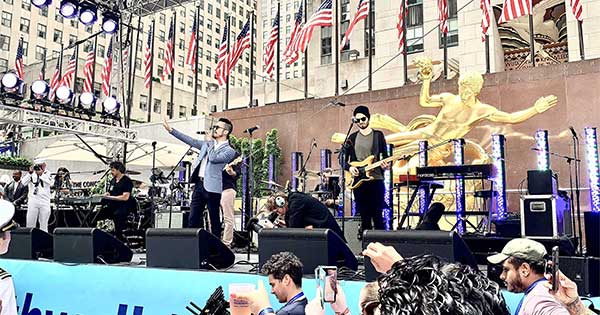 Dr. Jeffrey Le '07 performing on stage with his band in Rockefeller Center