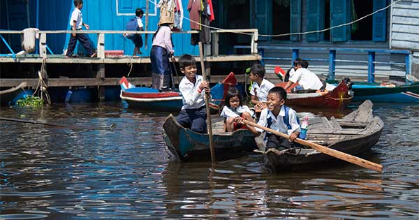 kids in boats on their way to school in Cambodia