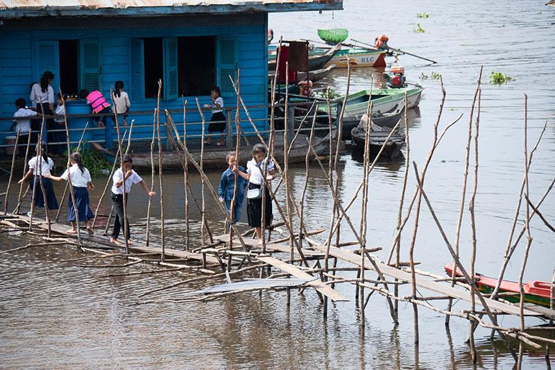 Students walking the bridge between schools