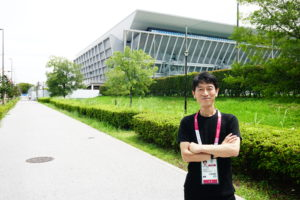 Takuya Adachi '04S (MBA) in front of the Tokyo Aquatics Centre