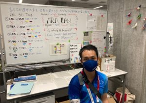 Yuske Shimizu '02 with a whiteboard used in the Ariake Arena
