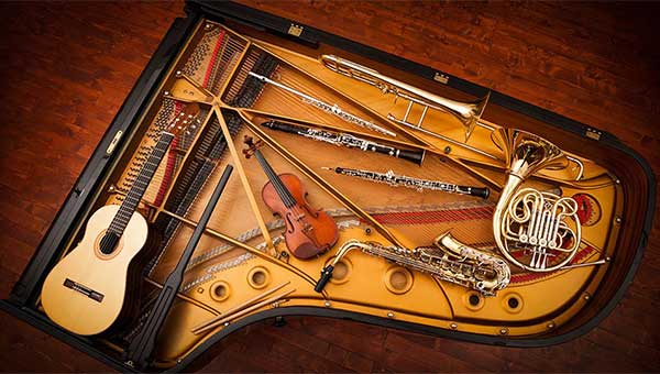 piano from the top opened with instruments laid out within it