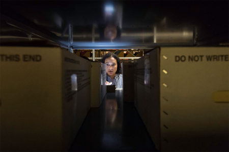 woman filing slaughter papers in storage