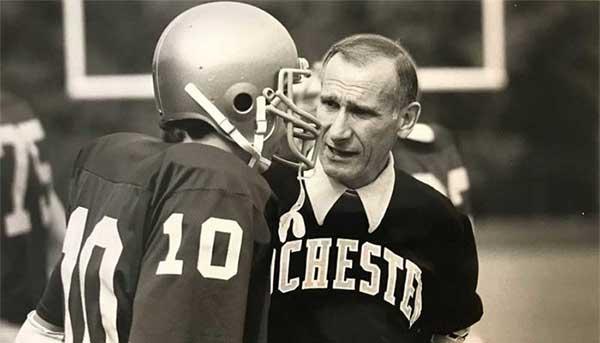 Coach Stark talking to quarterback on sideline