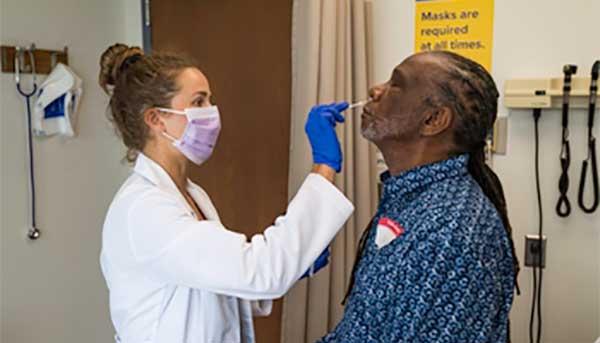 man getting a COVID-19 test