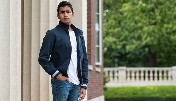 Brian Basu '21 is one several Puerto Rican college students displaced by Hurricane Maria who came to Rochester in 2018 for a guest semester then stayed as a fulltime student. (University of Rochester photo / J. Adam Fenster)