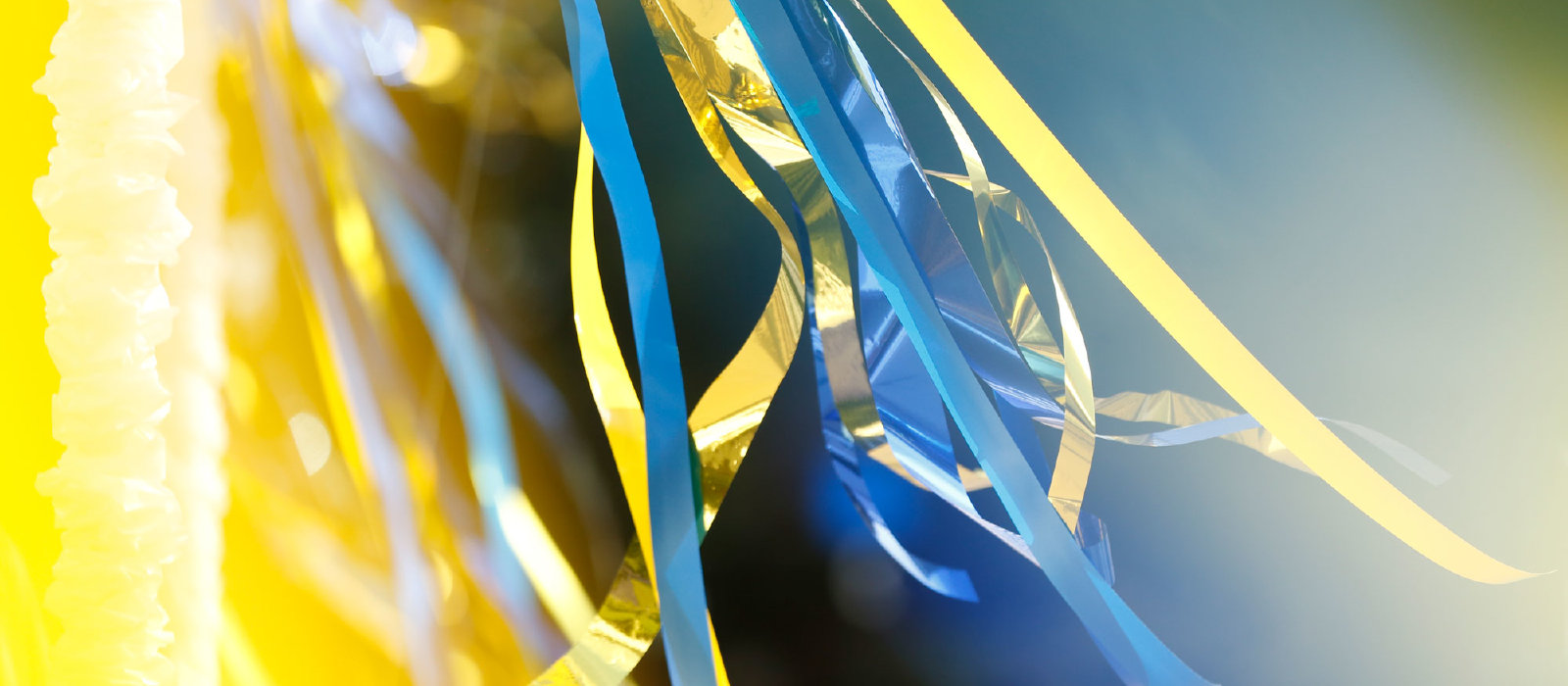 blue and gold ribbon zoomed up closely