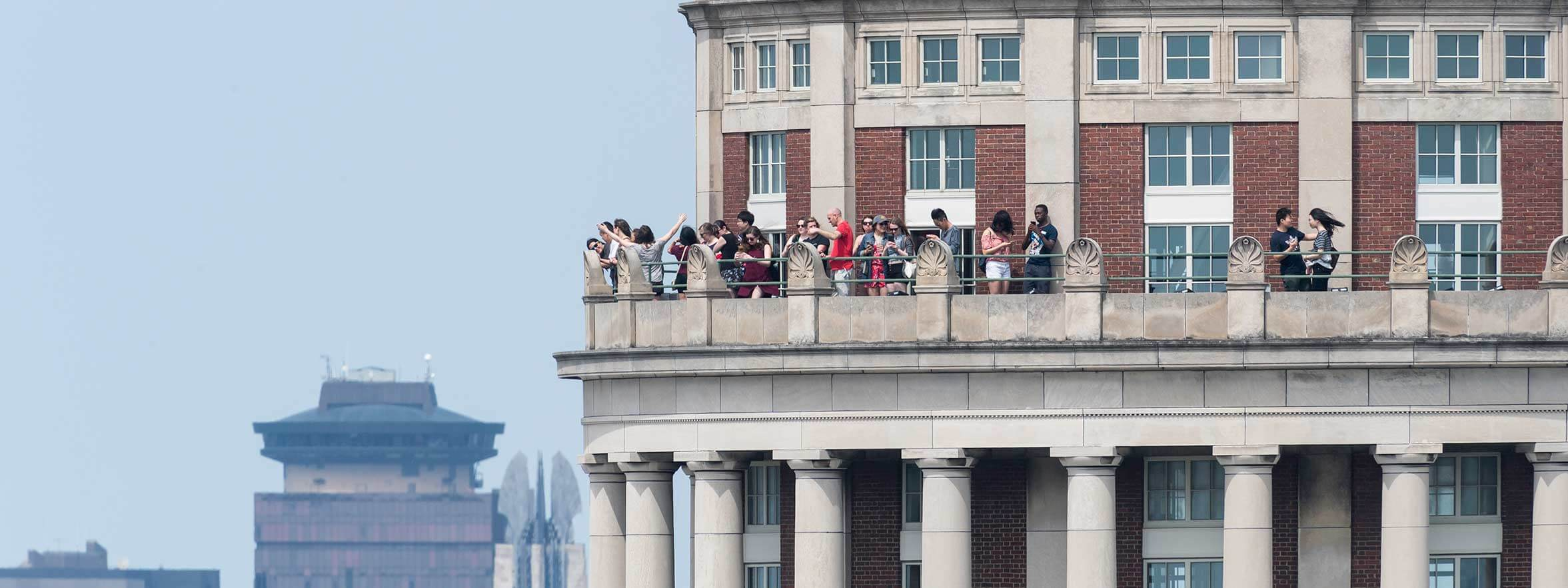 Students on balcony at Rochester, a tier one research university