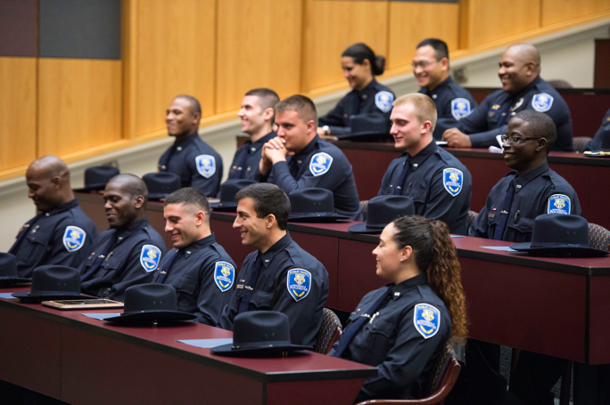 Public safety officers attend a graduation ceremony at the University of Rochester