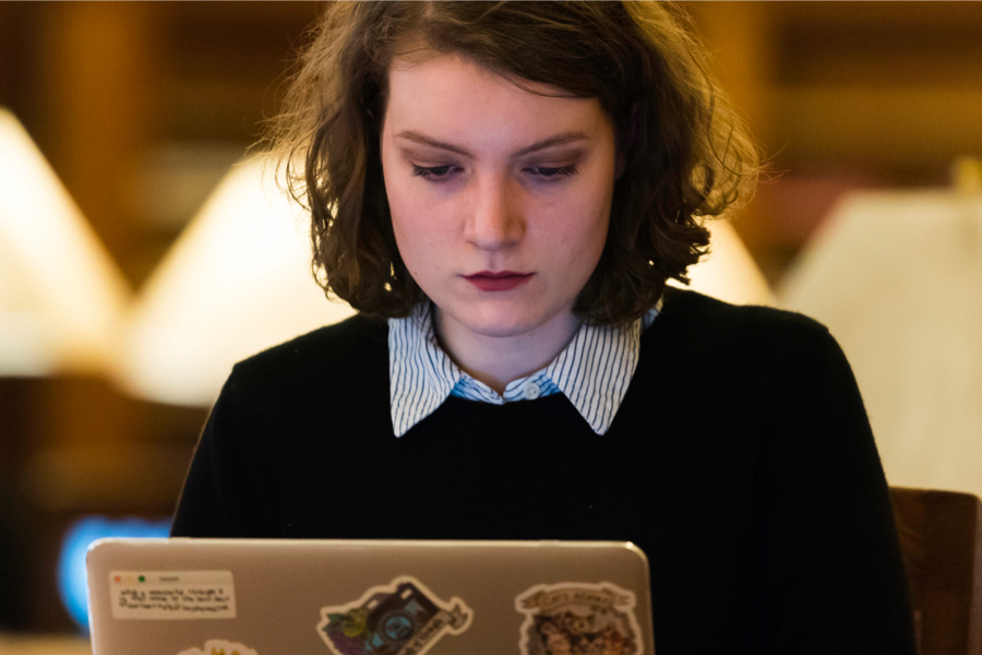 A student works on a computer in the library