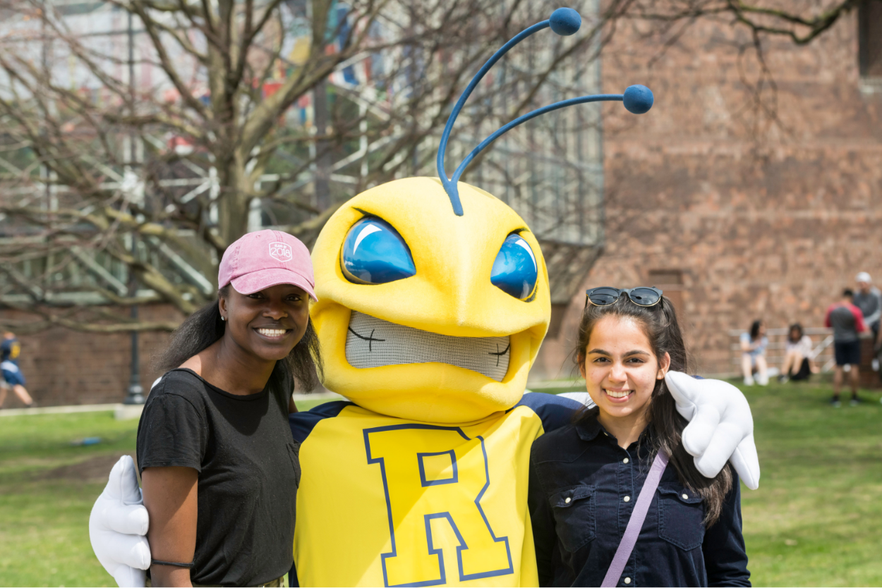 University of Rochester mascot, Rocky, with two students