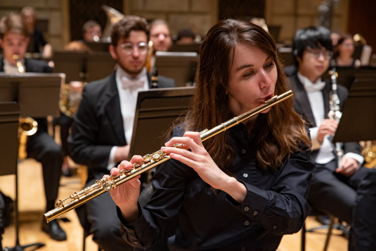 A performance occurs at Eastman School of Music