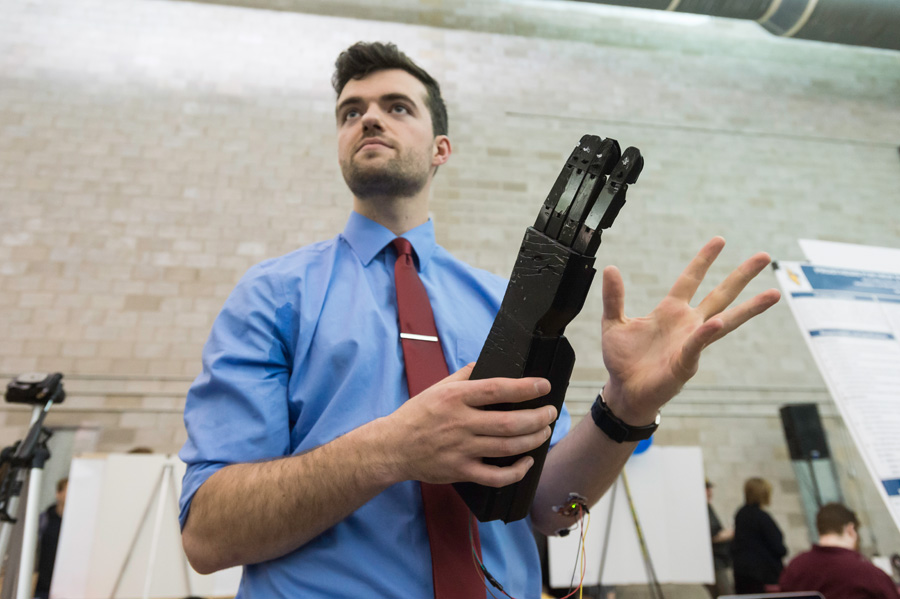 Mechanical engineering student with prosthetic arm at University of Rochester Hajim School of Engineering and Applied Sciences
