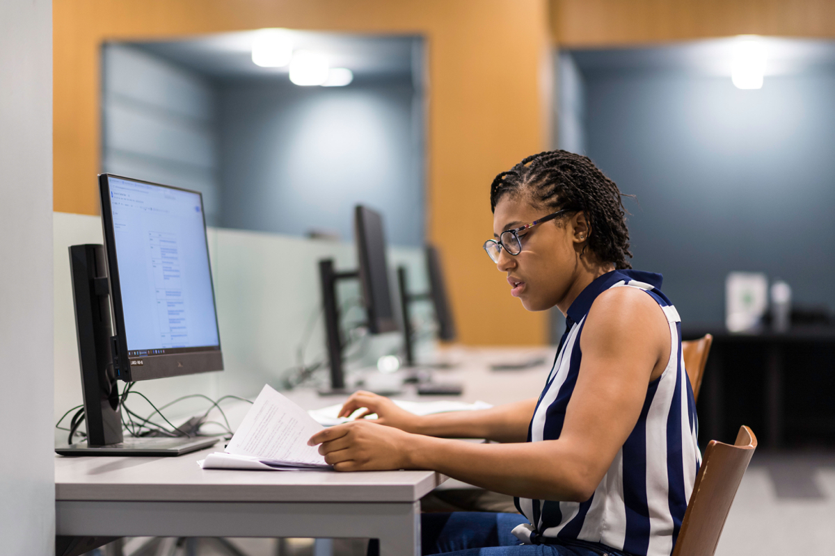 Student works in a computer lab at University of Rochester
