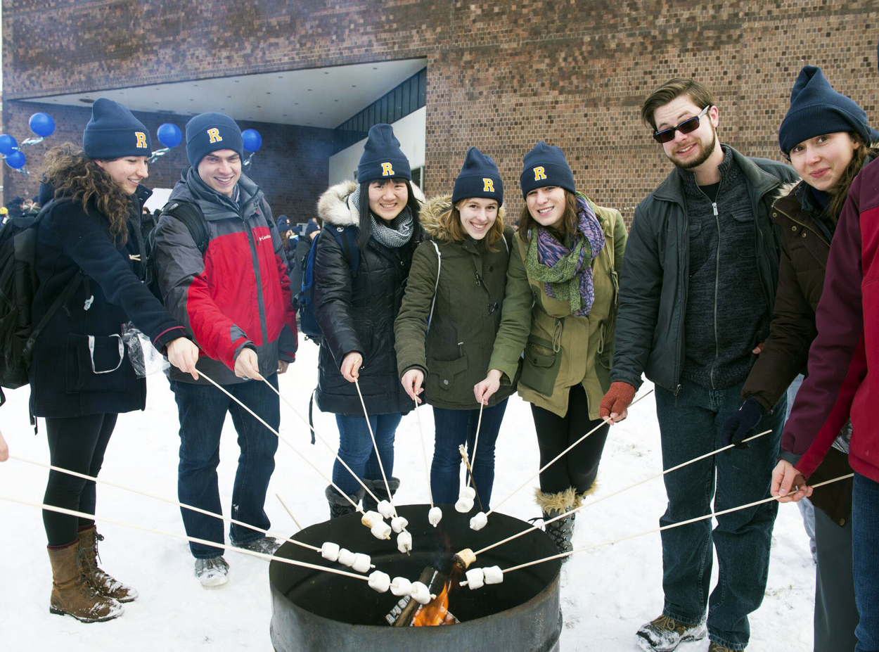 Students roast marshmallows during Winterfest tradition at the University of Rochester