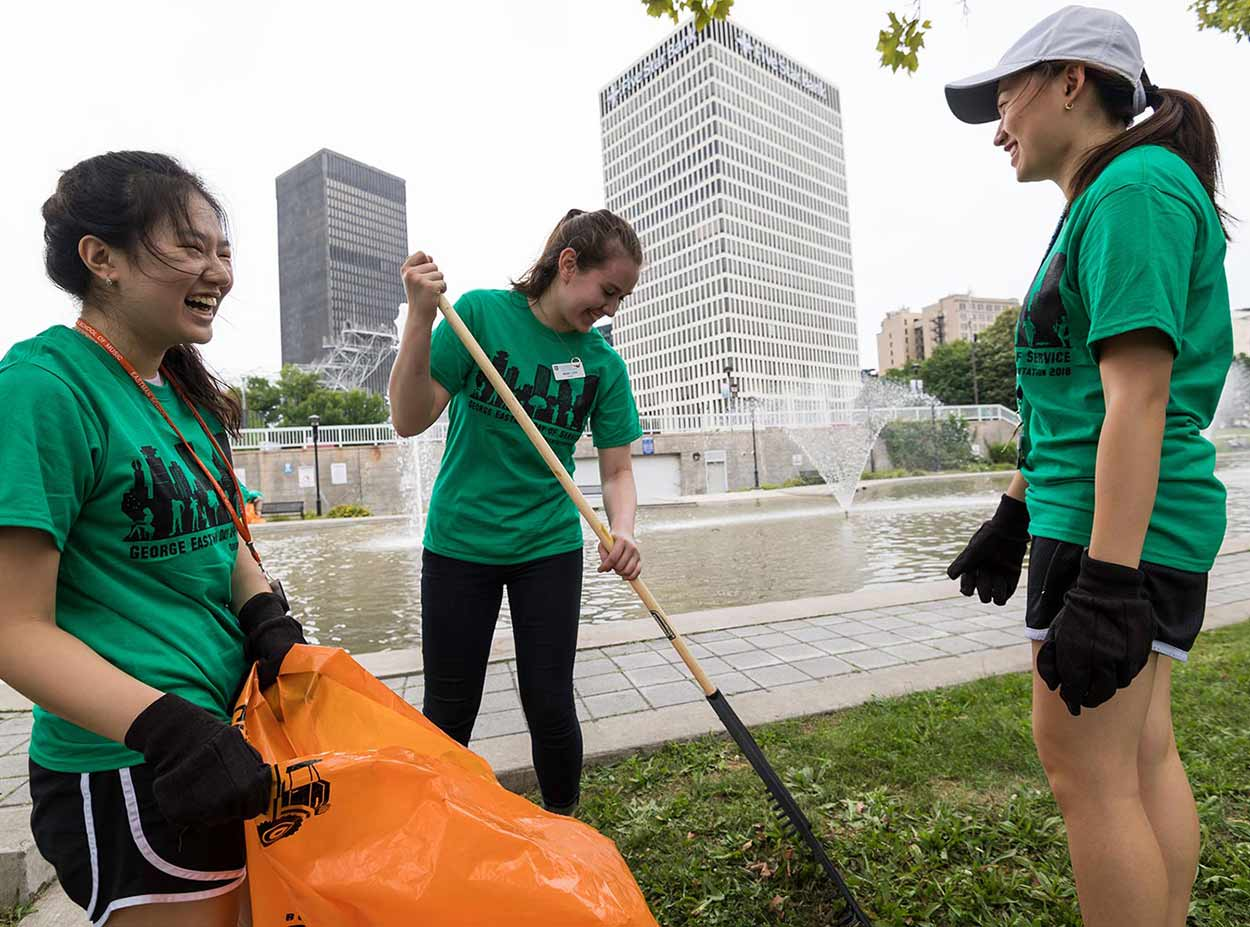University of Rochester students doing volunteer landscaping work for Wilson Day