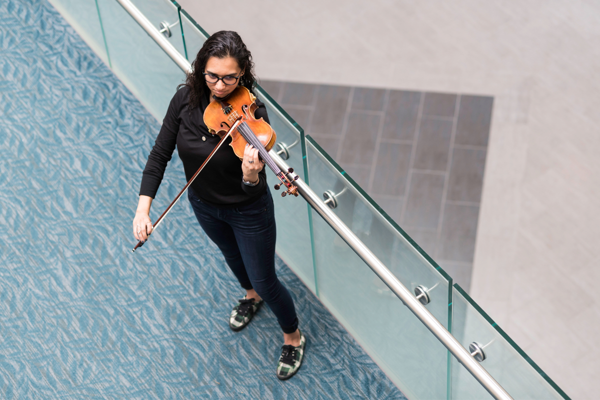 University of Rochester student play instrument
