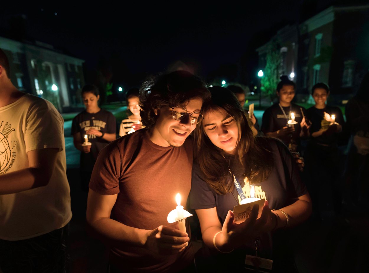 Students take part in the candlelight ceremony tradition at the University of Rochester