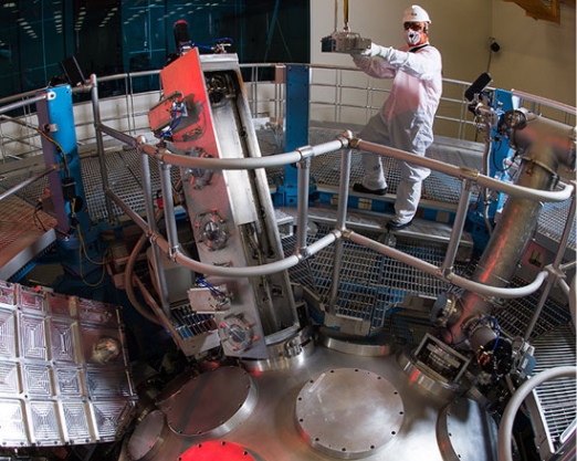 Researcher in lab clothing working on the omega laser at University of Rochester LLE