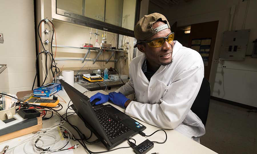 Researcher a laptop in lab at University of Rochester