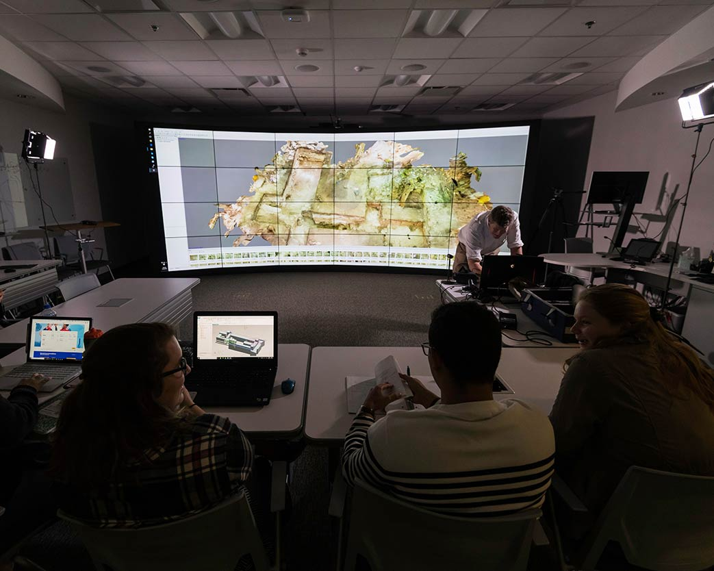 Classroom with a huge floor-to-ceiling curved data display