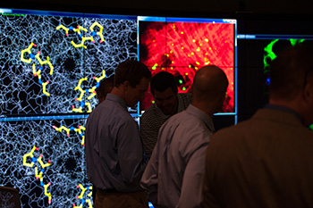 Visitors attend a preview of the Visualization-Innovation-Science-Technology-Application (VISTA) Collaboratory, University of Rochester's 1,000-square-foot data visualization lab located in Carlson Library.