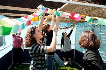 Students decorate a sukkah, a temporary dwelling built during the Jewish holiday of Sukkot.