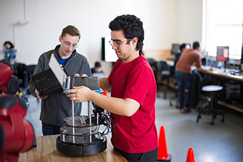 Electrical engineering students working on a project