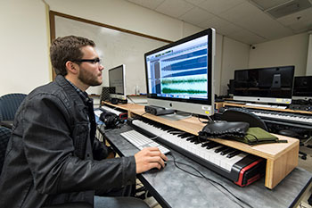 A student working in a music studio