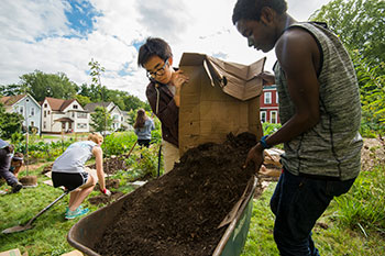 Students working in a community garden