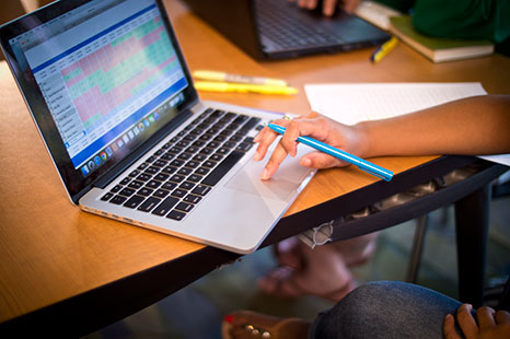 A student working on a laptop