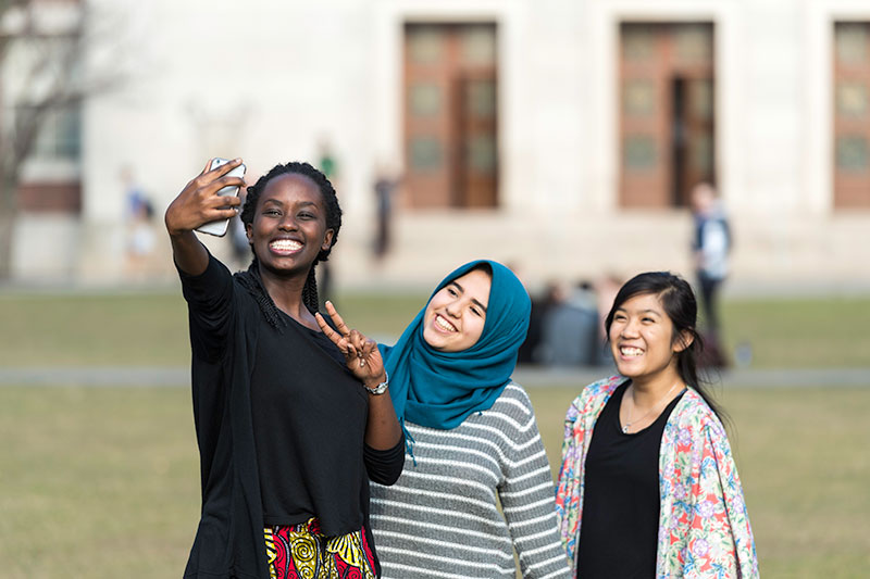 Students taking a selfi on campus